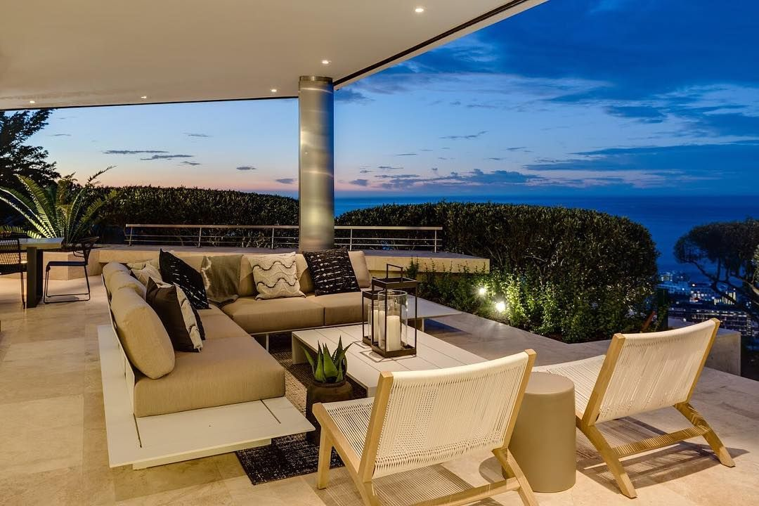 Image may contain: Moondance Villa, Made in Chelsea, Cape Town, South Africa, MIC, location, price, booking, cost, pictures, inside, Coffee Table, Couch, Table, Indoors, Housing, Building, Balcony, Chair, Furniture