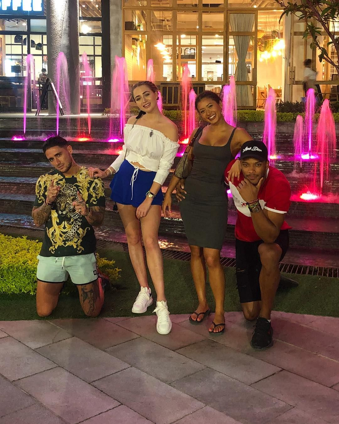 Image may contain: Kaz and Theo, Kazimir Crossley, Kaz Crossley, Theo Campbell, Love Island, dating, girlfriend, boyfriend,Female, Water, Skirt, Shoe, Footwear, Shorts, Human, Person, Apparel, Clothing