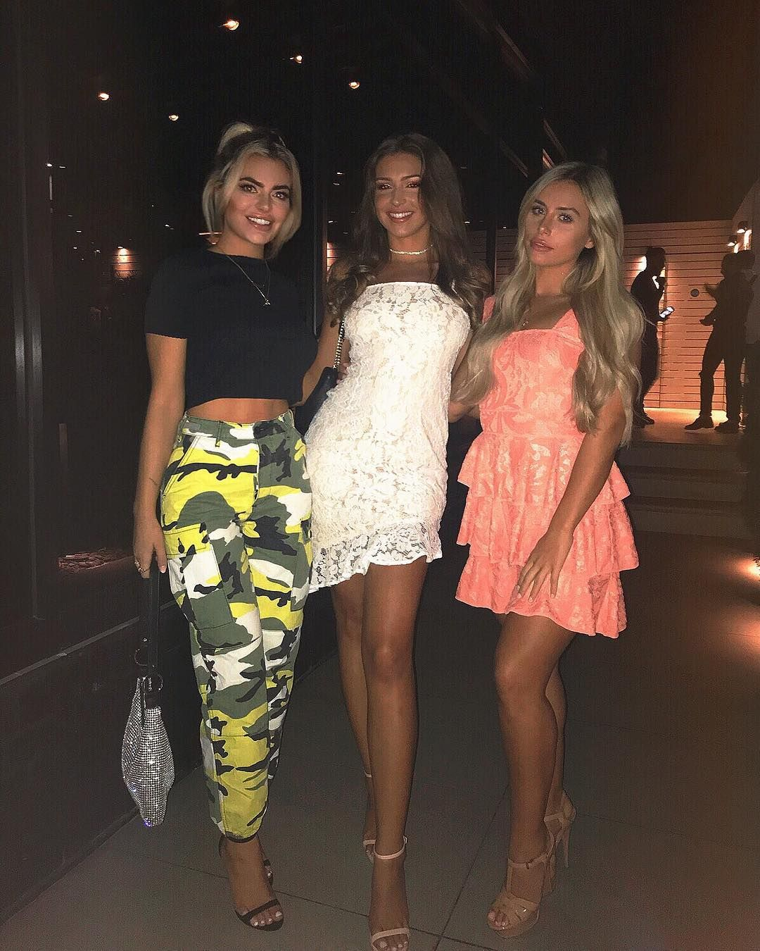 Image may contain: Charlie and Megan, Love Island, Charlie Brake, Megan Barton Hanson, Zara McDermott, Ellie Brown, Footwear, Shoe, Robe, Evening Dress, Gown, Premiere, Fashion, Clothing, Apparel, Human, Person