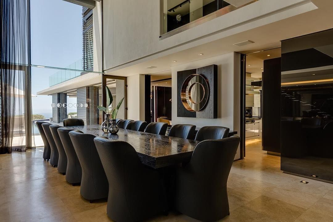 Image may contain: Moondance Villa, Cape Town, South Africa, Made in Chelsea, location, cost, book, pictures,  Home Decor, Housing, Building, Wood, Hardwood, Living Room, Floor, Chair, Furniture, Meeting Room, Conference Room, Flooring, Interior Design, Room, Indoors