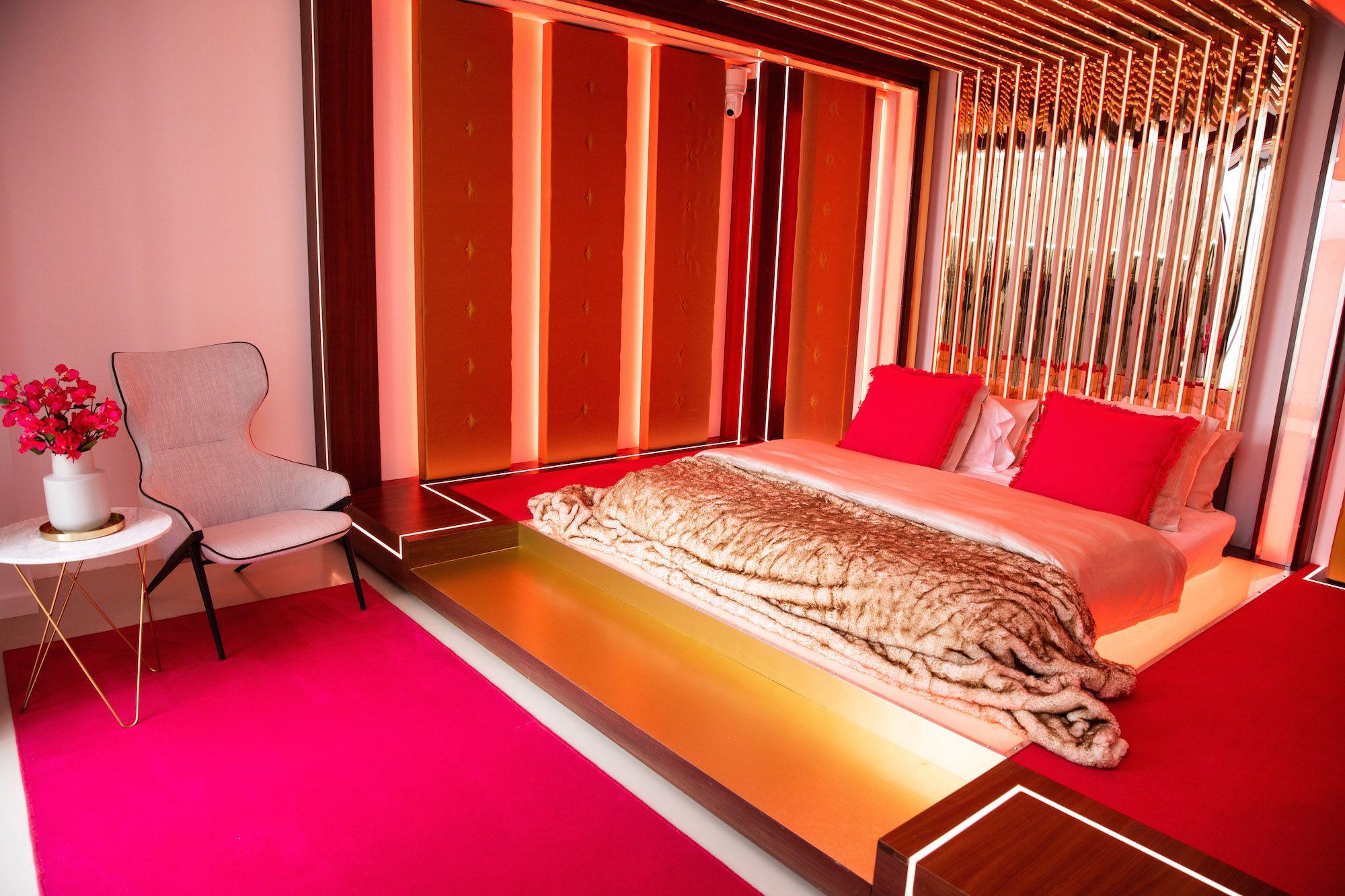 Image may contain: Love Island villa, 2019, villa, Love Island, location, Majorca, Hotel, Rug, Wood, Bed, Bedroom, Lighting, Room, Housing, Building, Chair, Interior Design, Indoors, Furniture