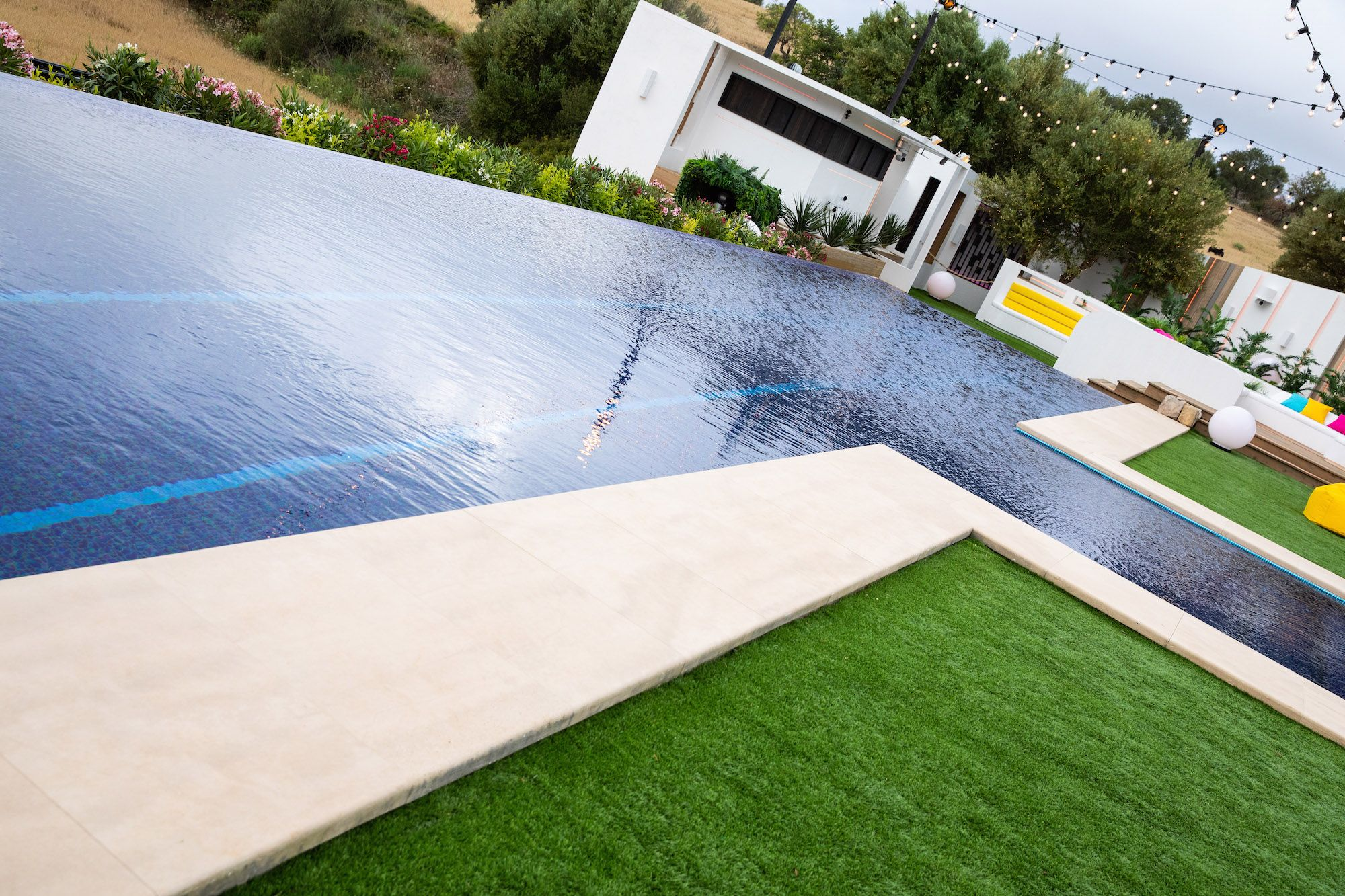 Image may contain: Love Island villa, Love Island 2019, villa, location, inside, first look, Sant Llorenç des Cardassar, Majorca, Outdoors, Hotel, Rug, Swimming Pool, Building, Pool, Water, Grass, Plant