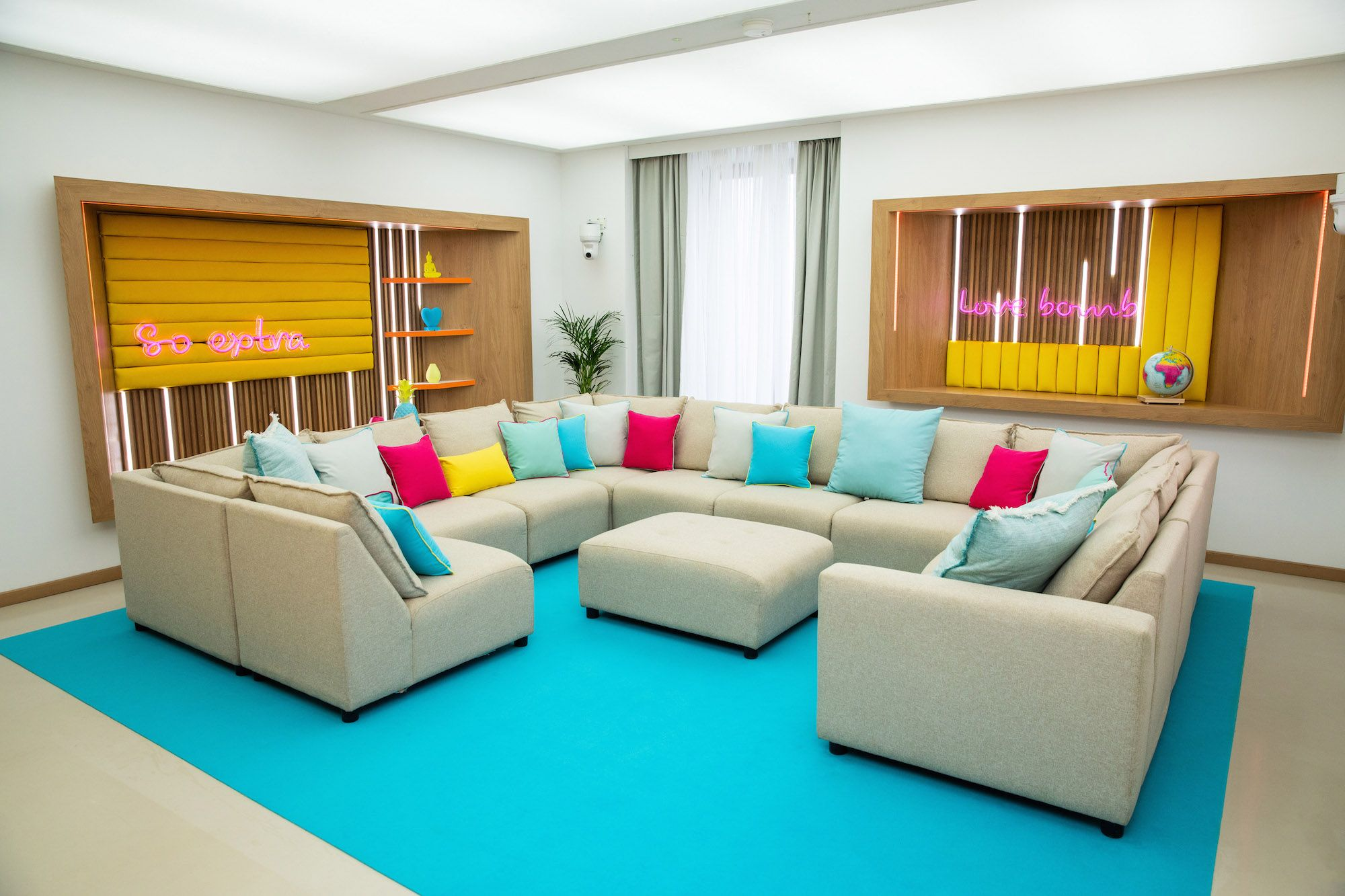 Image may contain: Love Island villa, Sant Llorenç des Cardassar, Love Island, villa, location, 2019, pictures, inside, first look, Pillow, Coffee Table, Cushion, Rug, Interior Design, Table, Living Room, Indoors, Room, Couch, Furniture