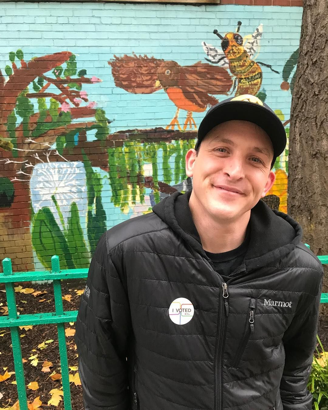 Image may contain: You season 2 cast, You, Netflix, Robin Lord Taylor, Will, season 2, cast, list, Portrait, Photo, Photography, Painting, Mural, Art, Tree, Plant, Wall, Outdoors, Face, Human, Person, Clothing, Apparel, Coat, Jacket