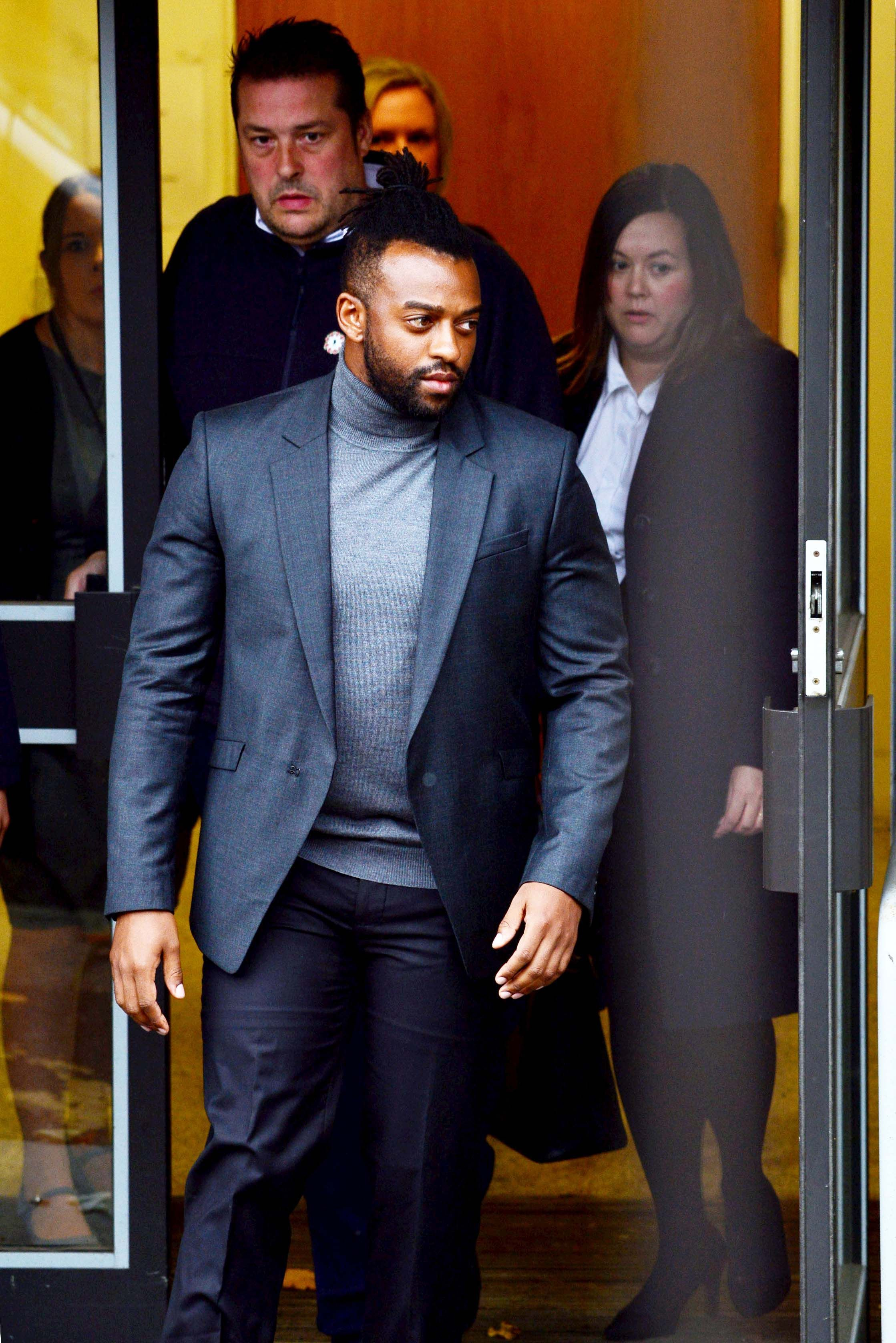 Image may contain: Ortise Williams not guilty, Oritse Williams, trial, JLS, court, result, rape, guilty, not guilty, Wolverhampton, Premiere, Apparel, Overcoat, Coat, Suit, Clothing, Fashion, Human, Person