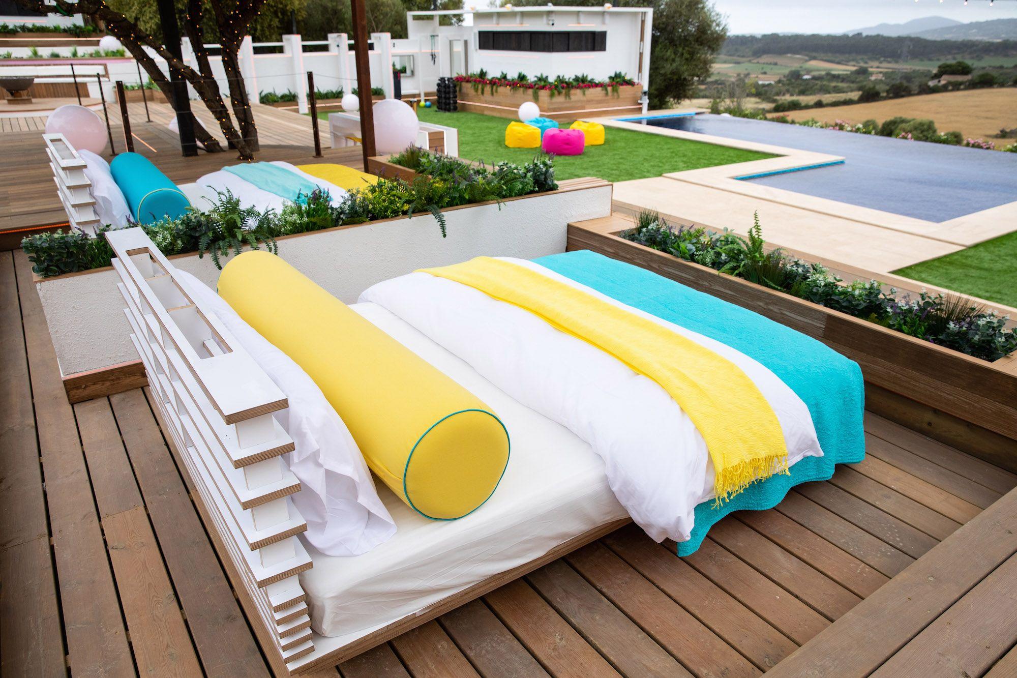 Image may contain: Love Island villa, Love Island, location, 2019, Rug, Bridge, Boardwalk, Hotel, Pool, Building, Wood, Water