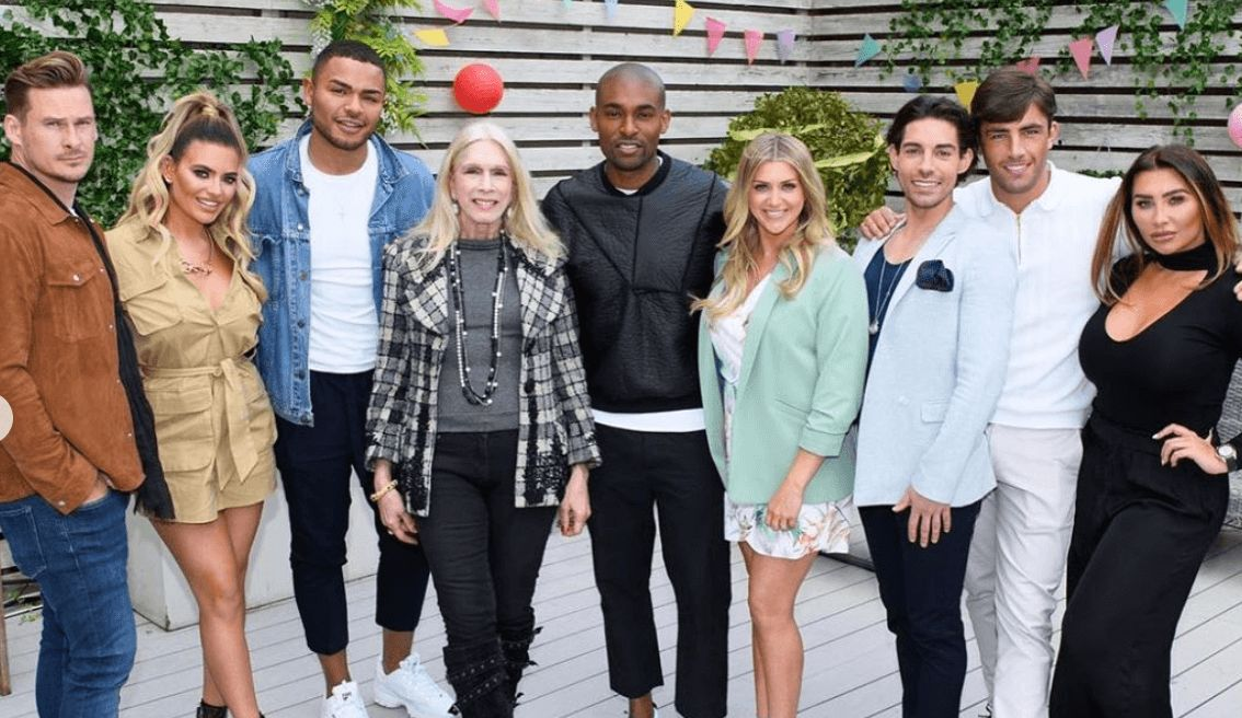 Image may contain: be on Celebs Go Dating, how to apply, Celebs Go Dating, 2019, date a celebrity, Sleeve, Long Sleeve, Family, Blazer, Female, Coat, Jacket, People, Denim, Jeans, Footwear, Shoe, Person, Human, Clothing, Pants, Apparel