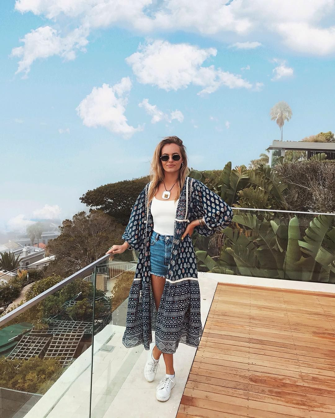 Image may contain: Moondance Villa, Cape Town, Made in Chelsea, South Africa, Eliza Batten, MIC,Sleeve, Plywood, Wood, Apparel, Clothing, Person, Human, Accessories, Accessory, Sunglasses, Balcony
