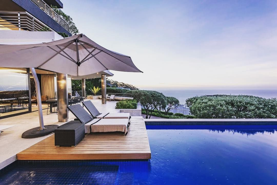 Image may contain: Moondance Villa, Made in Chelsea, house, location, South Africa, Cape Town, cost, booking, price,  Swimming Pool, Tent, Resort, Hotel, Pool, Water, Building