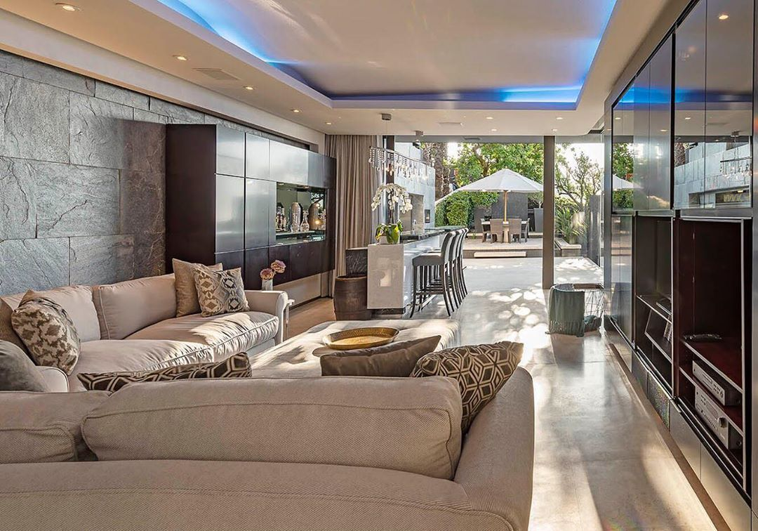 Image may contain: Moondance Villa, Cape Town, Made in Chelsea, South Africa, Table, Flooring, Rug, Lobby, Couch, Interior Design, Furniture, Living Room, Indoors, Room, Housing, Building