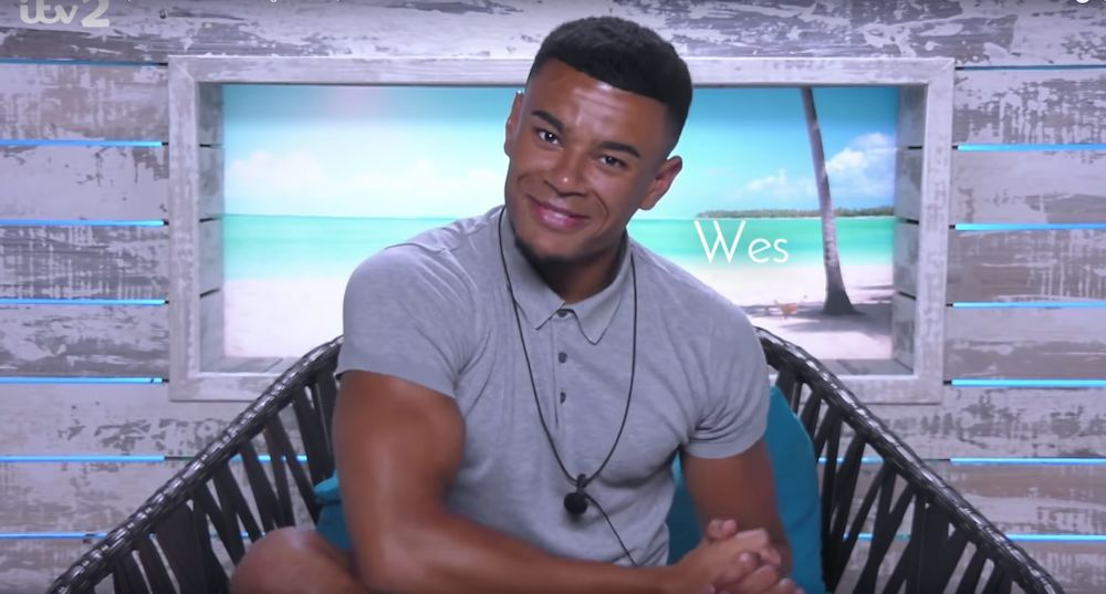 Image may contain: Love Island villa, 2019, Love Island, location, Video Gaming, Outdoors, Face, Chair, Furniture, People, Human, Person