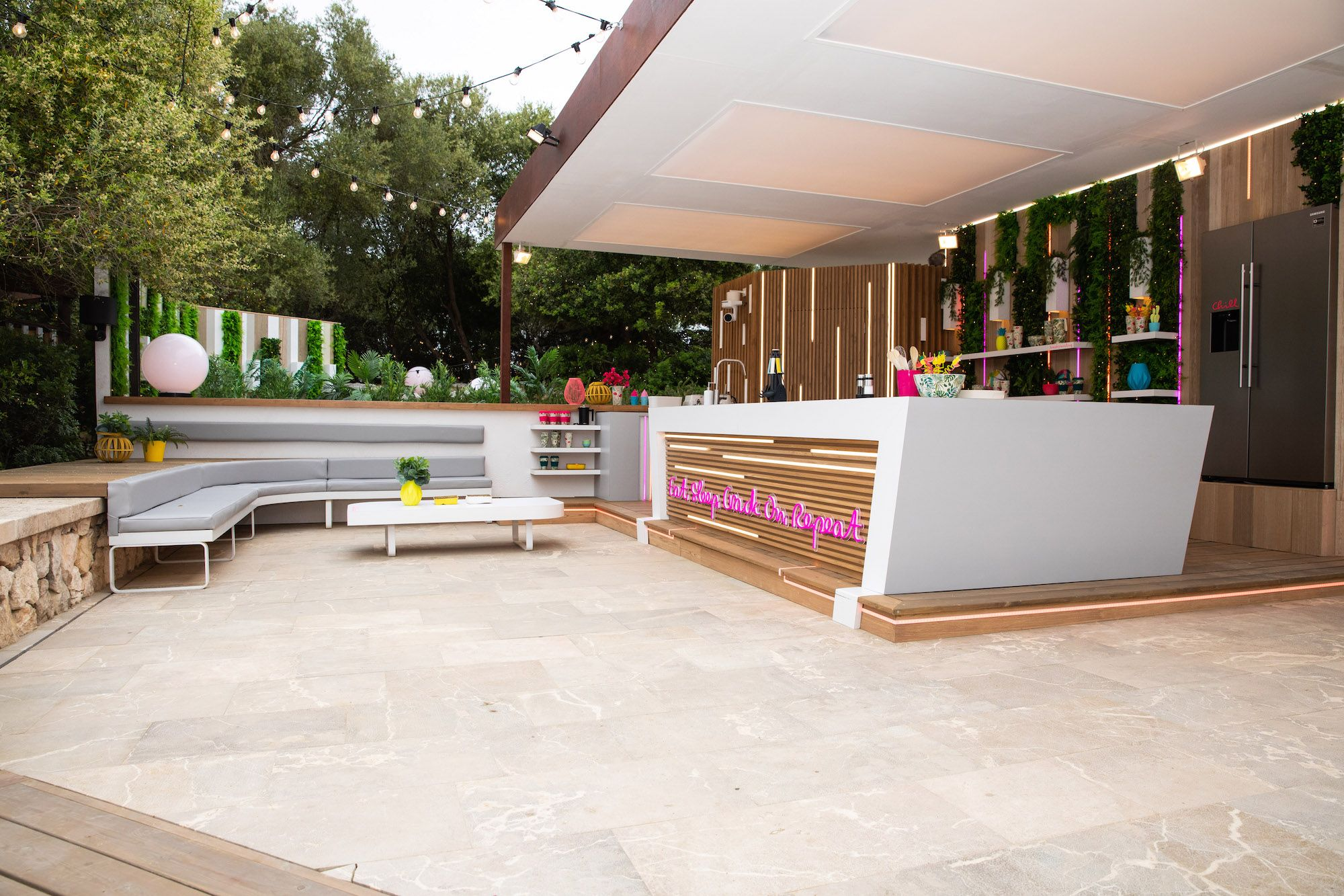 Image may contain: Love Island villa, Love Island, 2019, location, Sant Llorenç des Cardassar, Wood, Couch, Human, Person, Flooring, Reception, Table, Furniture