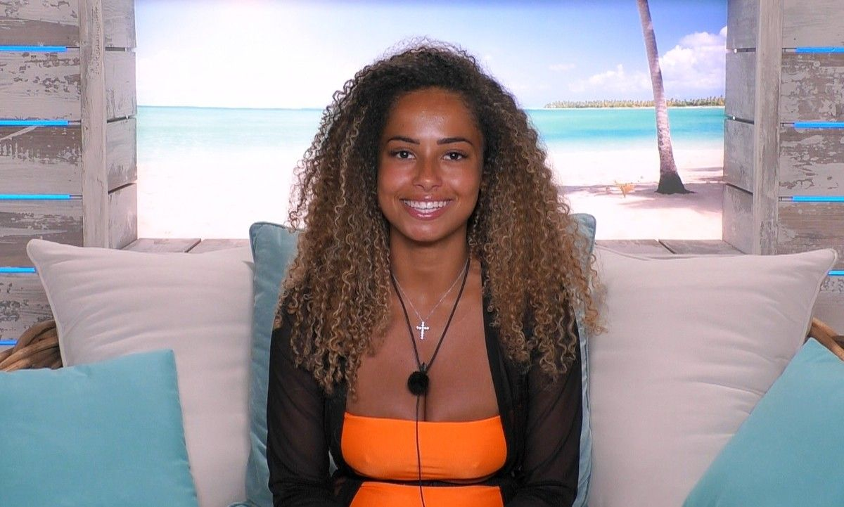 Image may contain: Love Island star signs, Amber, Love Island, Leo, star sign, compatible, age, birth, Accessory, Necklace, Jewelry, Accessories, Woman, Furniture, Couch, Clothing, Apparel, Pillow, Female, Cushion, Person, Human