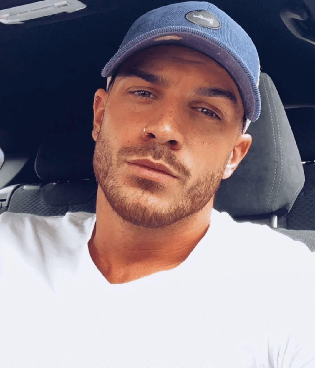 Image may contain: Casa Amor cast, Casa Amor, Love Island, Dan Rose, contestant, cast, Islander, new, boy, Instagram, age, job, Cap, Hat, Headrest, Clothing, Apparel, Face, Person, Human, Cushion