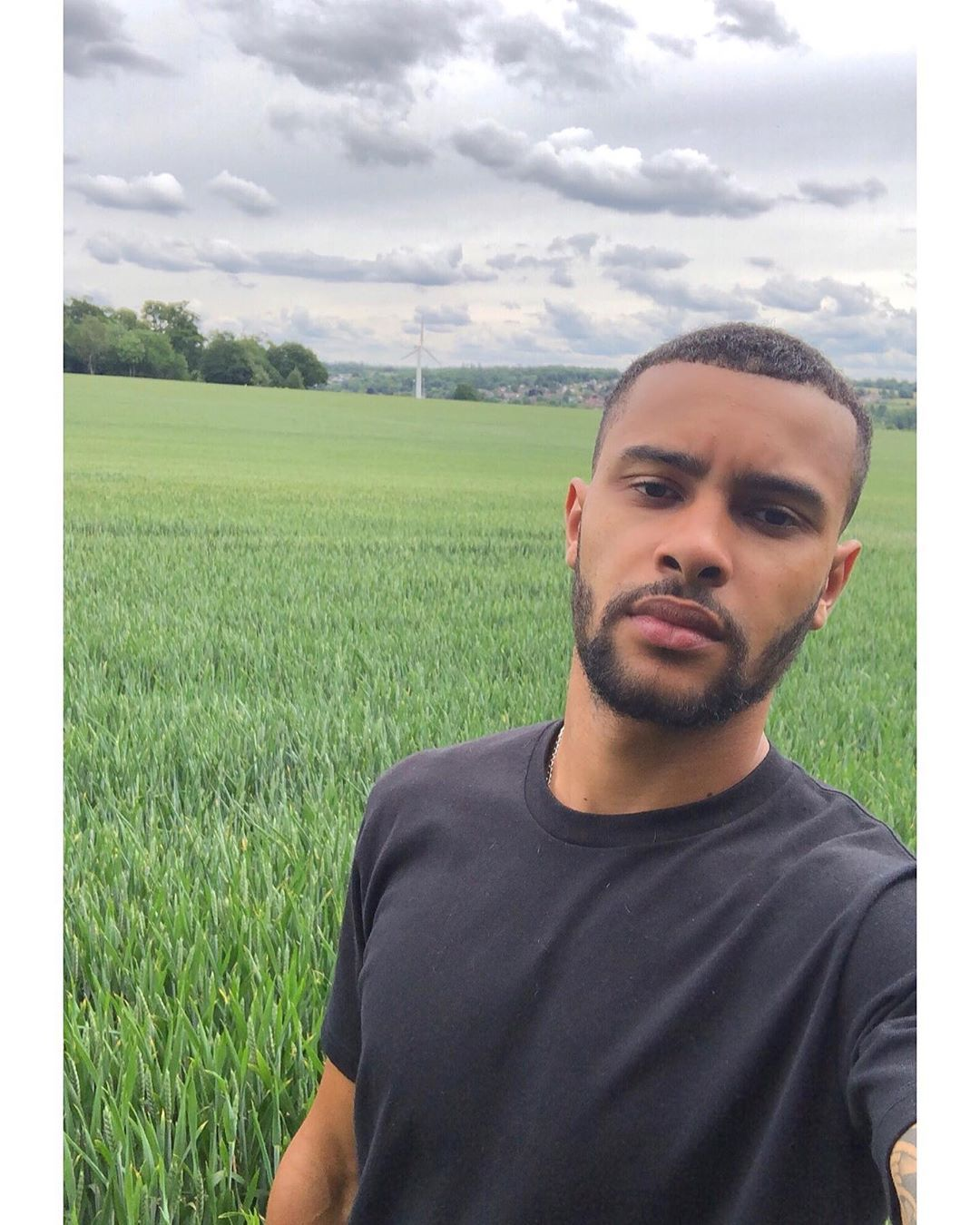 Image may contain: Casa Amor Islanders, Casa Amor, Love Island, Dennon Lewis, Islander, cast, contestant, new, Instagram, rumours, gossip, lineup, latest, date, Land, Paddy Field, Beard, Man, Vegetation, Countryside, Grass, Plant, Grassland, Field, Outdoors, Nature, Face, Person, Human