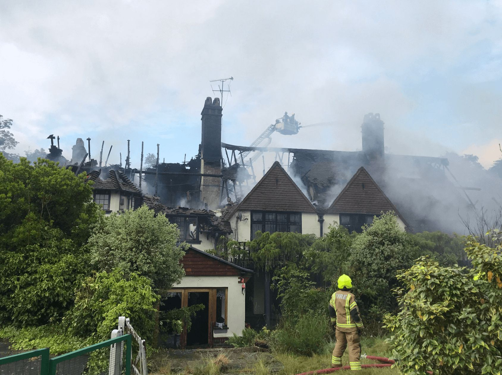 Image may contain: Oritse Williams house fire, Oritse Williams, JLS, house, fire, mansion, burned down, damage, pictures, news, Nature, Building, Outdoors, Roof, Human, Person