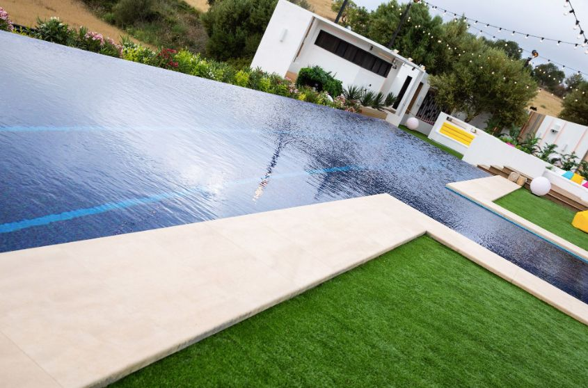 Image may contain: Outdoors, House, Villa, Swimming Pool, Housing, Building, Grass, Plant, Pool, Water