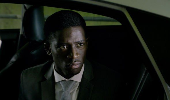 Image may contain: Smithereens ending explained, Black Mirror, Smithereens, season 5, episode 2, conclusion, ending, spoilers, easter eggs, died, death, answers, explained, Jaden, Damson Idris, Photo, Portrait, Photography, Man, Accessory, Accessories, Tie, Suit, Clothing, Apparel, Coat, Overcoat, Human, Face, Person