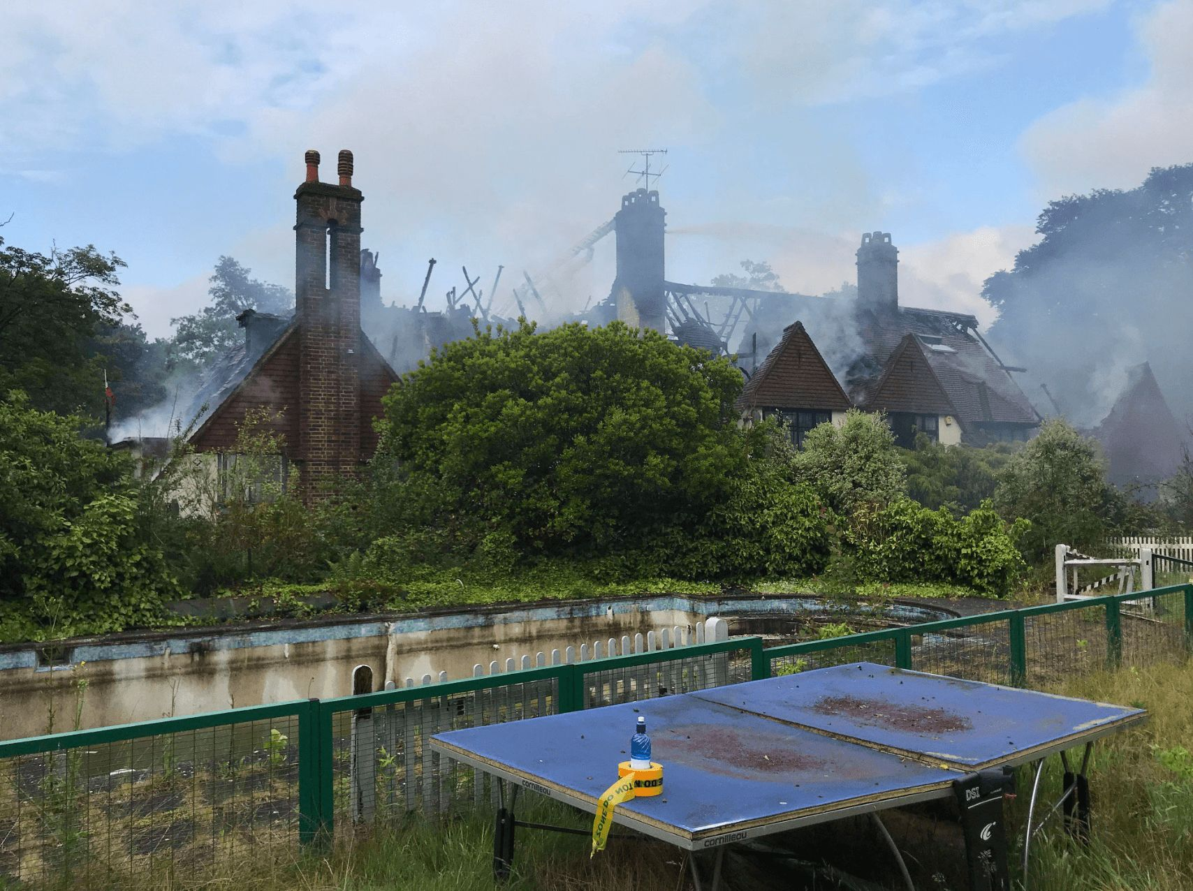 Image may contain: Oritse Williams house fire, Oritse Williams, house, fire, mansion, croydon, london, fire, Tub, Hot Tub, Jacuzzi, Transportation, Vehicle, Watercraft, Vessel, Roof, Shelter, Rural, Countryside, Building, Nature, Outdoors
