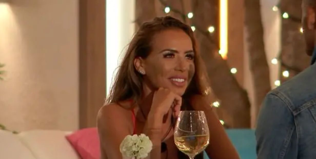 Image may contain: Love Island star signs, Elma, star sign, Love Island, Undershirt, Female, Wine Glass, Clothing, Apparel, Face, Alcohol, Wine, Beverage, Drink, Glass, Human, Person, Dating
