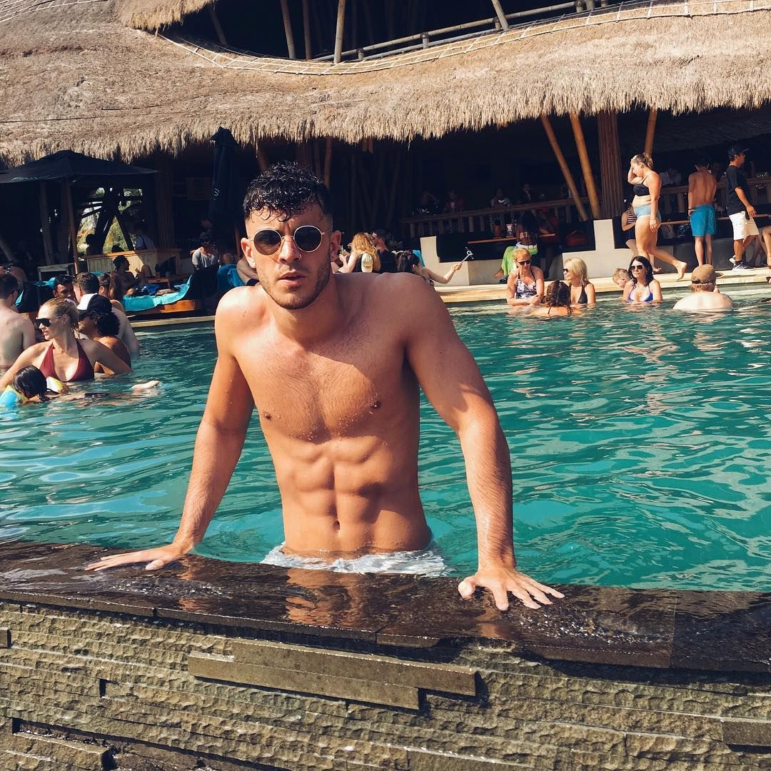 Image may contain: Casa Amor, Love Island, Dan Rose, Islander, cast, list, contestant, date, start, villa,  Vacation, Countryside, Swimming Pool, Nature, Outdoors, Accessory, Sunglasses, Accessories, Resort, Hotel, Pool, Building, Person, Human, Water