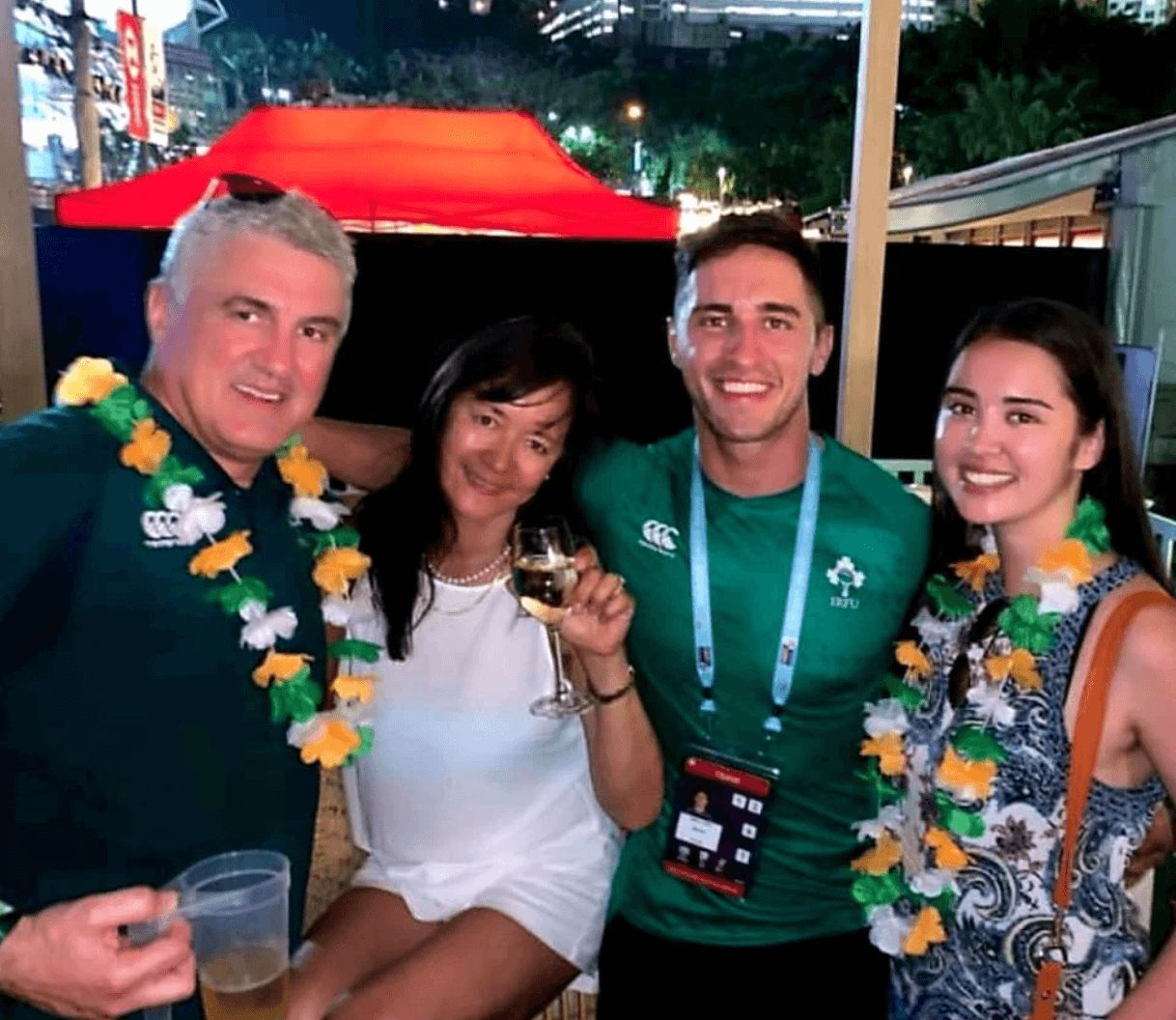 Image may contain: Love Island parents, Love Island, mum, dad, Greg, Lauren O'Shea, Niall, sister, Accessories, Sunglasses, Accessory, Lighting, Human, Flower Arrangement, Person, Flower, Blossom, Lei, Plant, Ornament