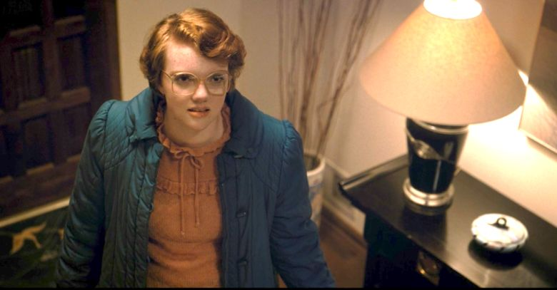 Image may contain: Stranger Things 3 end credit scene, post credits, Stranger Things 3, explained, theory, theories, ending, is Hopper dead, who, the American, door, spoilers, Netflix, finale, Stranger Things, Barb, alive, fan, Apparel, Clothing, Person, Human, Table Lamp, Lamp