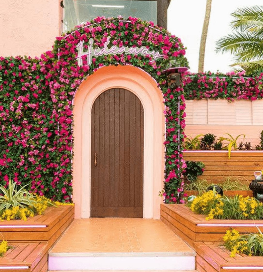 Image may contain: Love Island USA villa, Love Island USA, villa, Love Island, CBS, Fiji, Hideaway, Backyard, Door, Blossom, Flower, Arbour, Plant, Garden, Yard, Nature, Outdoors