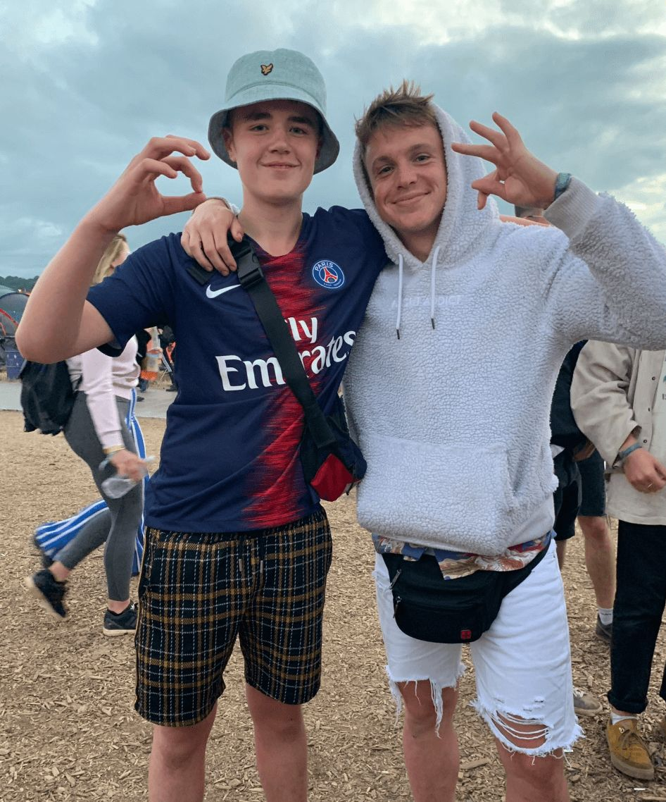 Image may contain: Alex Mann, Alex from Glastonbury, Glastonbury, Festival, Dave, rapping, boy, Glasto, stage, full video, Instagram, twitter, who, Alex, Baseball Cap, People, Sweater, Cap, Sleeve, Hat, Shoe, Footwear, Human, Person, Shorts, Apparel, Clothing