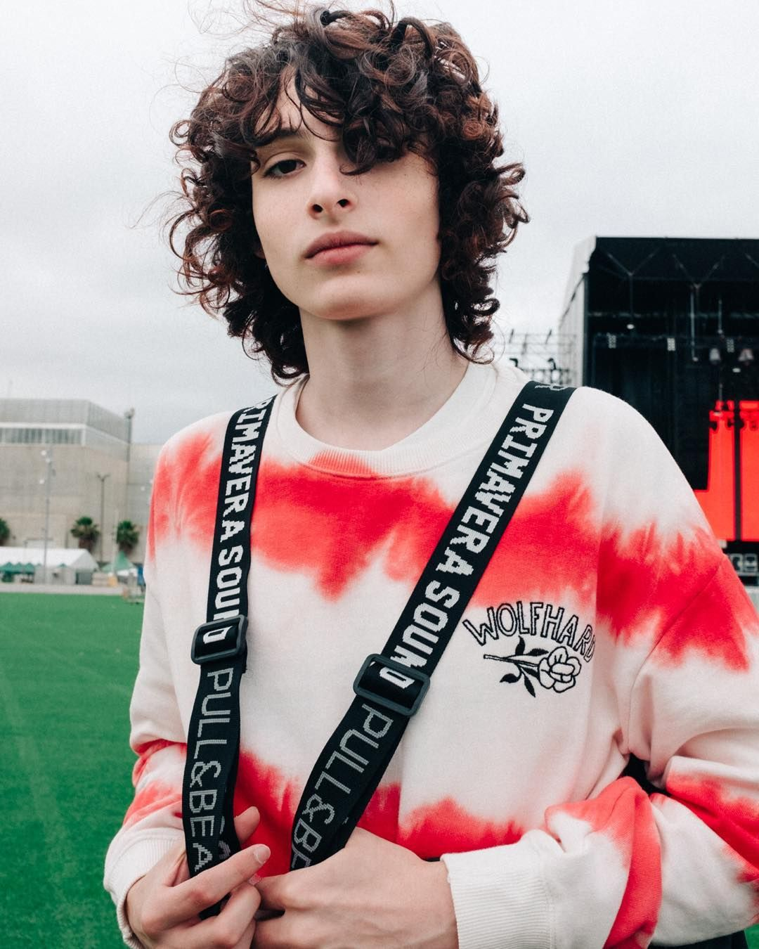 Image may contain:  Stranger Things cast ages, Stranger Things, 3, cast, age, old, birthday, Finn Wolfhard, Mike, Clothing, Sleeve, Apparel, Musical Instrument, Musician, Person, Human