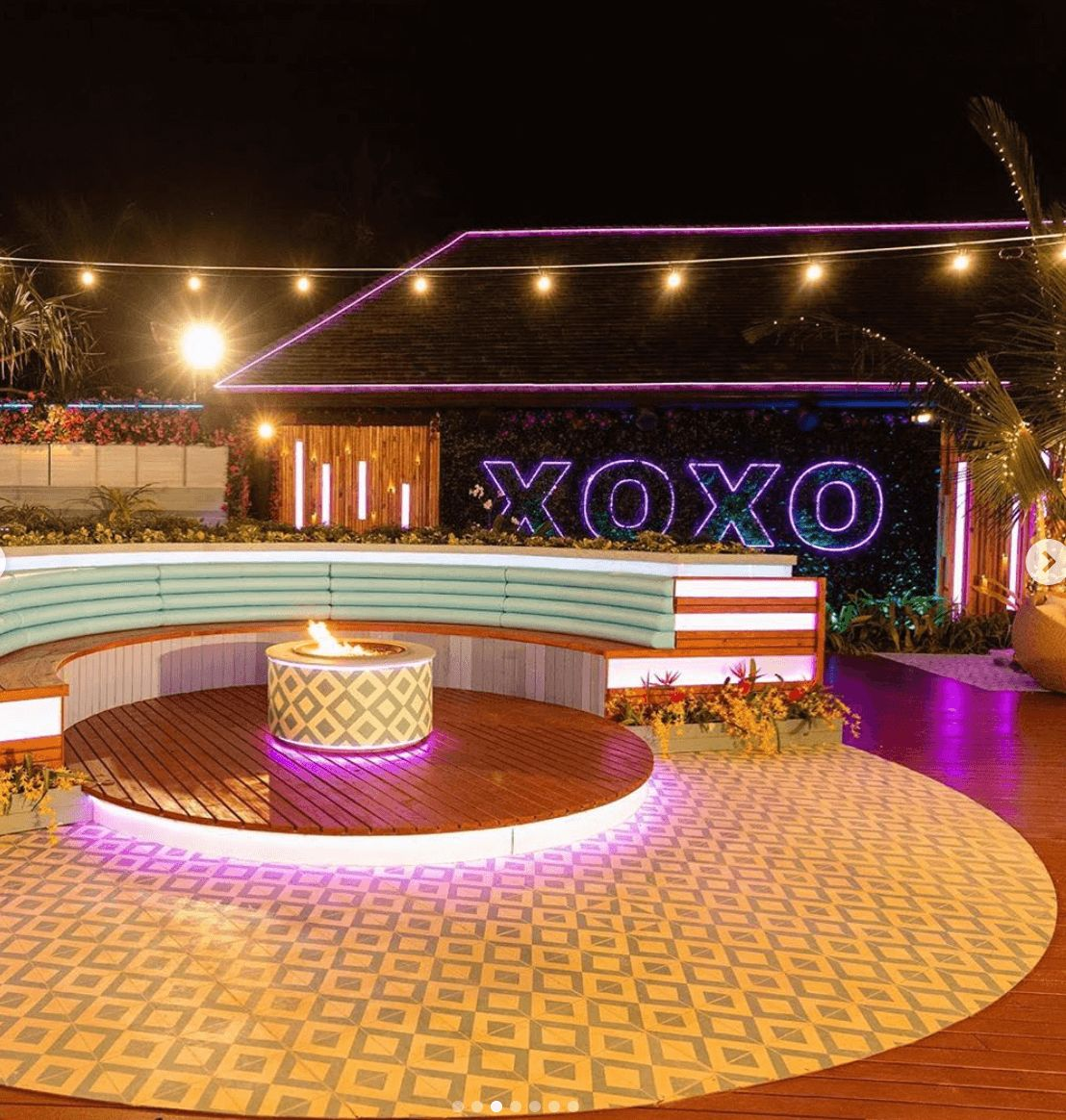 Image may contain: Love Island USA villa, Love Island USA, villa, Fiji, fire pit, Love Island, CBS Club, Crowd, Lighting