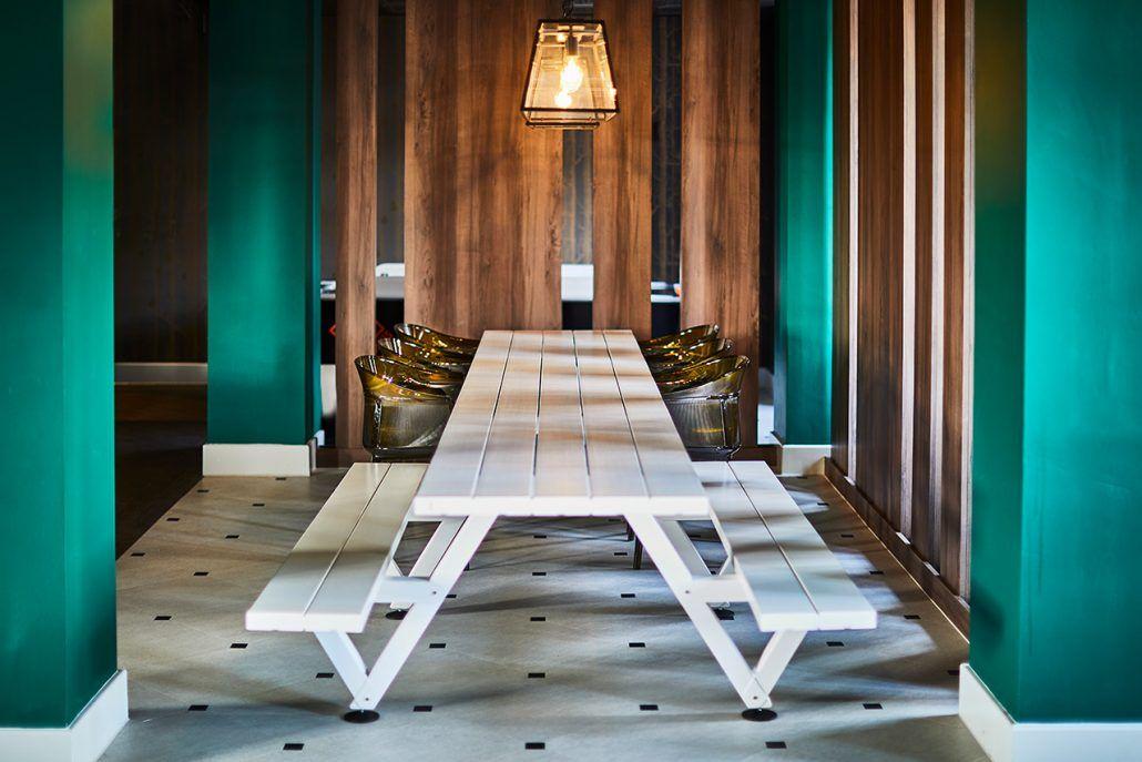 Image may contain: Dining Table, Table, Lobby, Hardwood, Plywood, Interior Design, Floor, Indoors, Room, Flooring, Wood, Furniture, Lighting