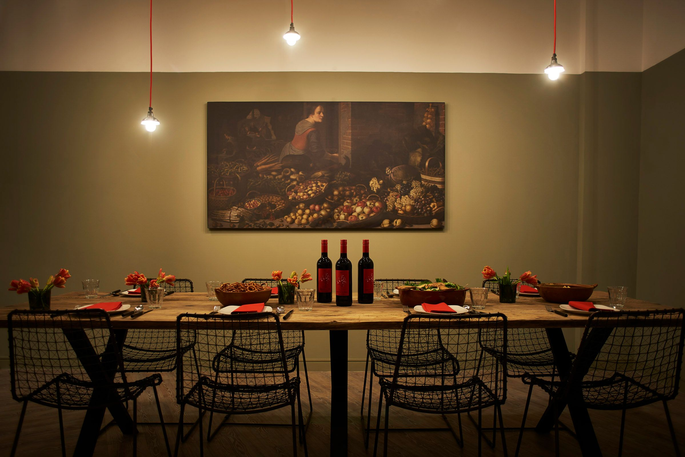 Image may contain: Indoors, Interior Design, Dining Table, Table, Wood, Wine, Bottle, Lighting, Restaurant, Alcohol, Drink, Beverage, Chair, Furniture