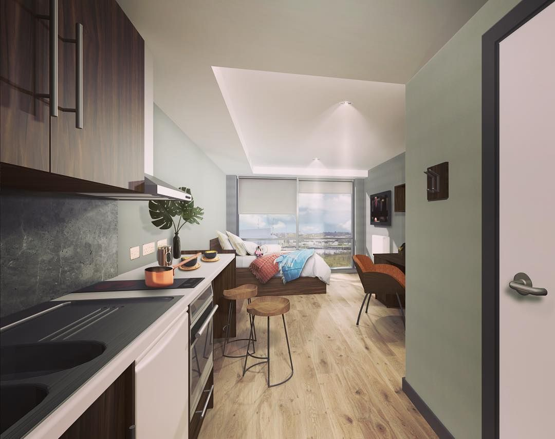 Image may contain: Interior Design, Kitchen, Floor, Hardwood, Chair, Furniture, Flooring, Wood, Indoors, Room