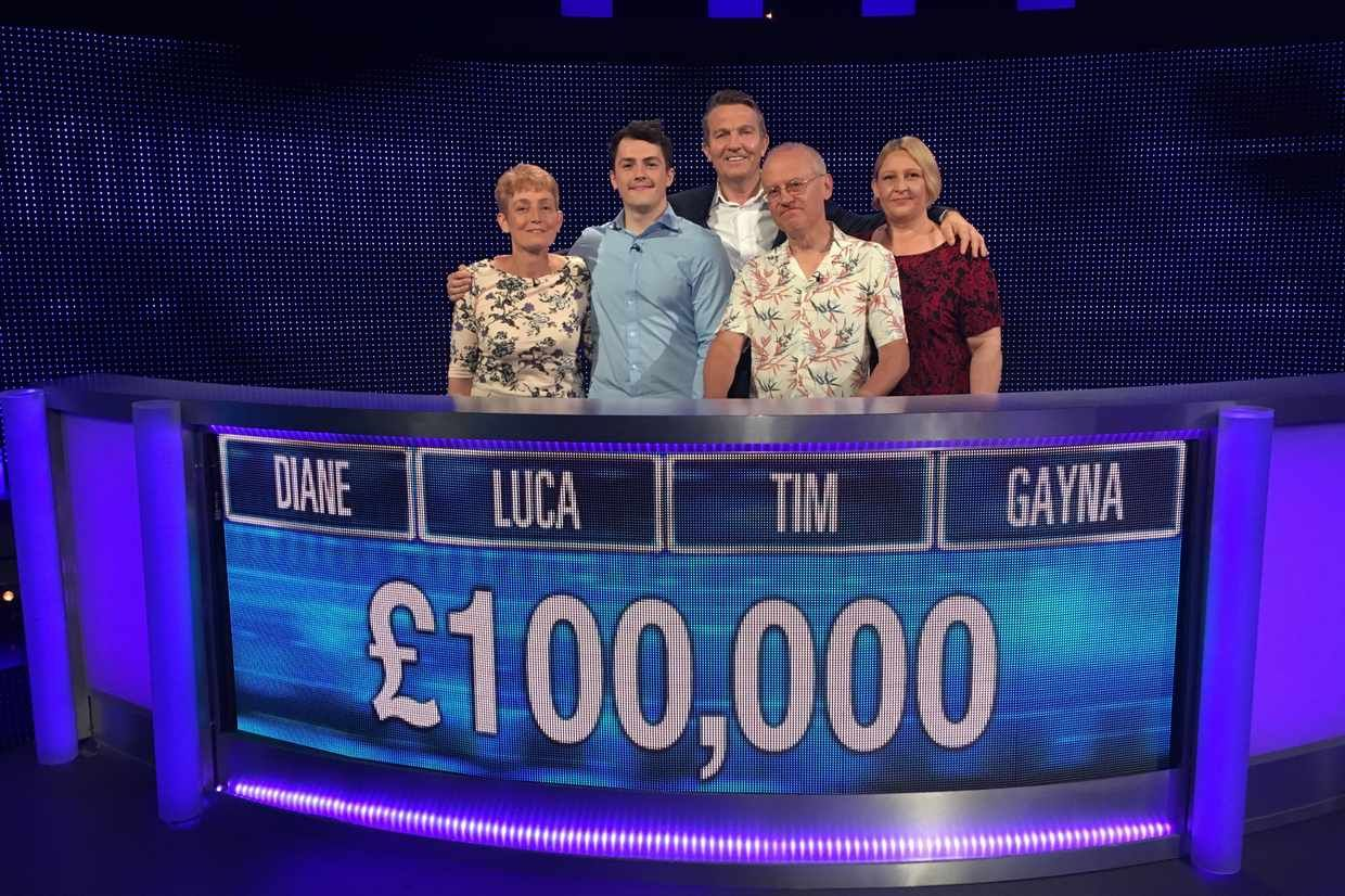 Image may contain: The Chase biggest wins, The Chase, ITV, wins, prize, money, cash, biggest, team, fund, final, builder, Bradley Walsh, Diane, Luca, Tim, Gayna, Stage, Alphabet, Electronics, Monitor, Screen, Display, Banner, Text, Person, Human