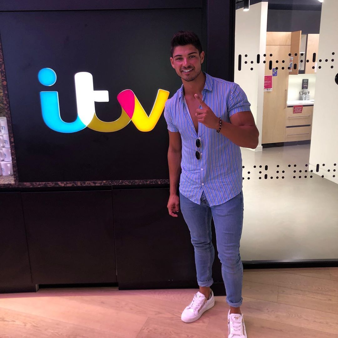 Image may contain: Love Island Instagrams, Love Island, Instagram, followers, ranking, 2019, Anton, Wood, Flooring, Pants, Long Sleeve, Sleeve, Human, Person, Apparel, Footwear, Shoe, Clothing