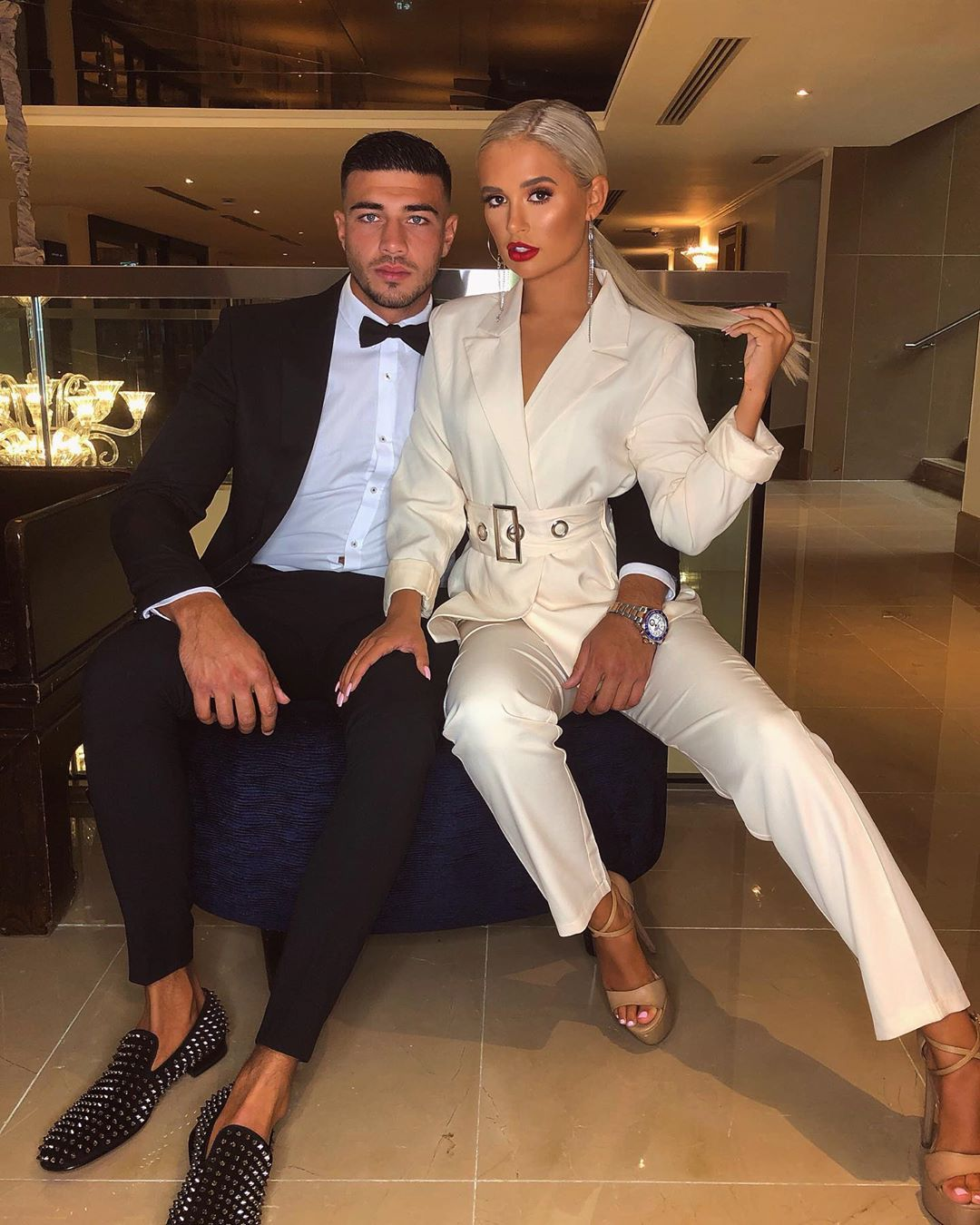 Image may contain: Molly-Mae and Tommy Ibiza, Molly-Mae Hague, Tommy Fury, Love Island, holiday, trip, Ibiza, Islanders, banned, Amy Hart, fake, Blazer, Jacket, Suit, Overcoat, Coat, Shoe, Footwear, Human, Person, Apparel, Clothing