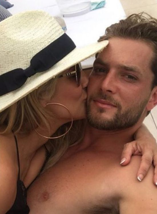 Image may contain: Caroline Flack's boyfriend, Lewis Burton, tennis, player, model, Caroline Flack, boyfriend, new, latest, news, gossip, ex, Instagram, age, holiday, pictures, Insta, story, official, Cap, Hat, Baseball Cap, Kiss, Kissing, Apparel, Clothing, Person, Face, Human