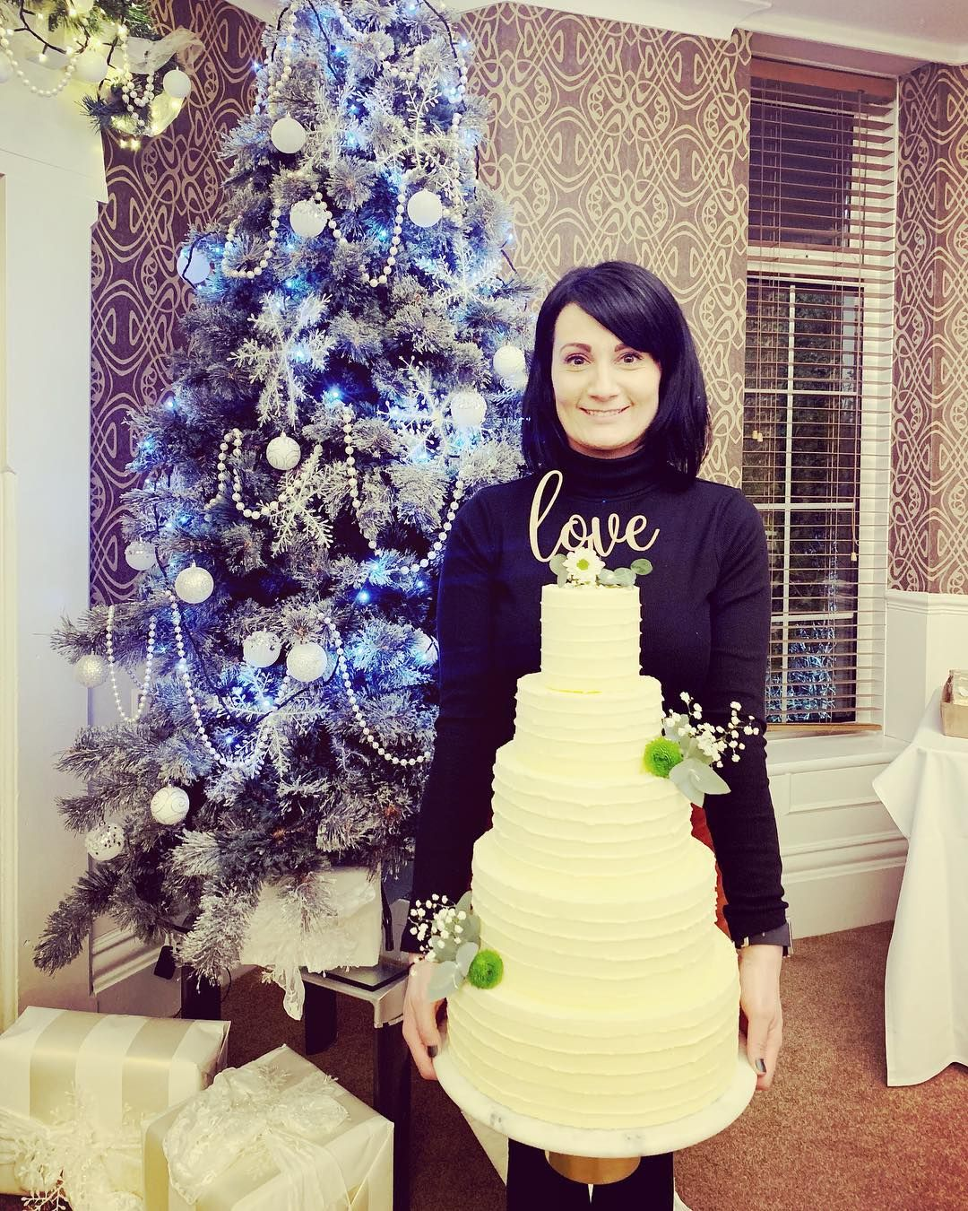 Image may contain: Great British Bake Off 2019, Michelle Evans-Fecci, Michelle, cast, contestants, lineup, Instagram, GBBO, Bake Off, 2019, start date, Channel 4, Christmas Tree, Ornament, Wedding Cake, Tree, Plant, Cake, Food, Dessert, Human, Person