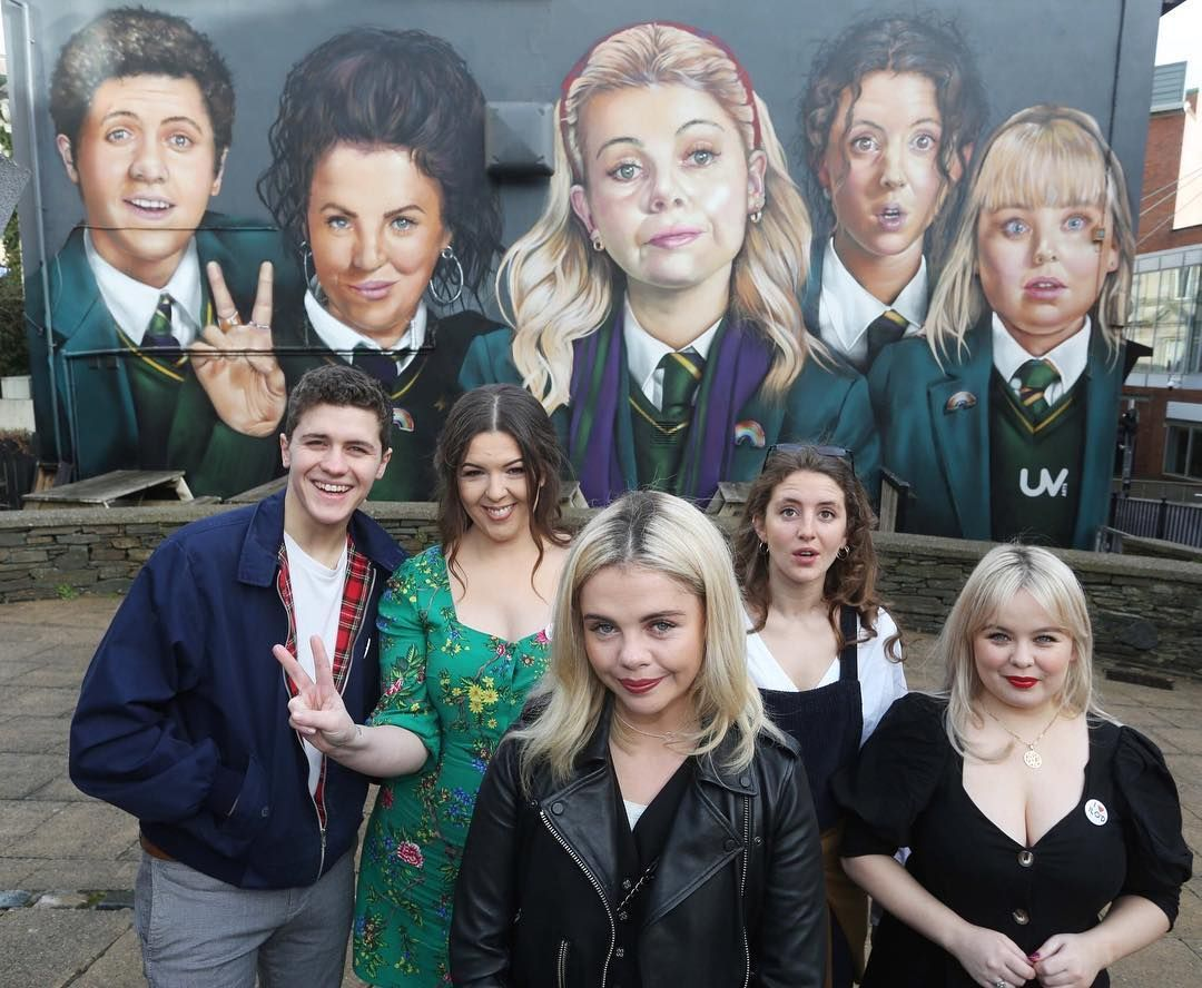 Image may contain: Derry Girls cast, Derry Girls, Netflix, Channel 4, season 2, season 3, Saoirse-Monica Jackson, Erin, Louisa Harland, Orla, Nicola Coughlan, Clare, Dylan Llewellyn, James, Jame-Lee O'Donnell, Michelle, Coat, Jacket, Apparel, Clothing, Human, Person