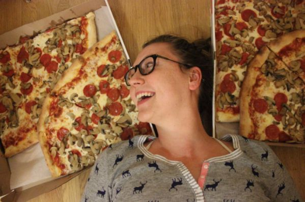 Image may contain: Face, Accessory, Accessories, Glasses, Person, Human, Pizza, Food