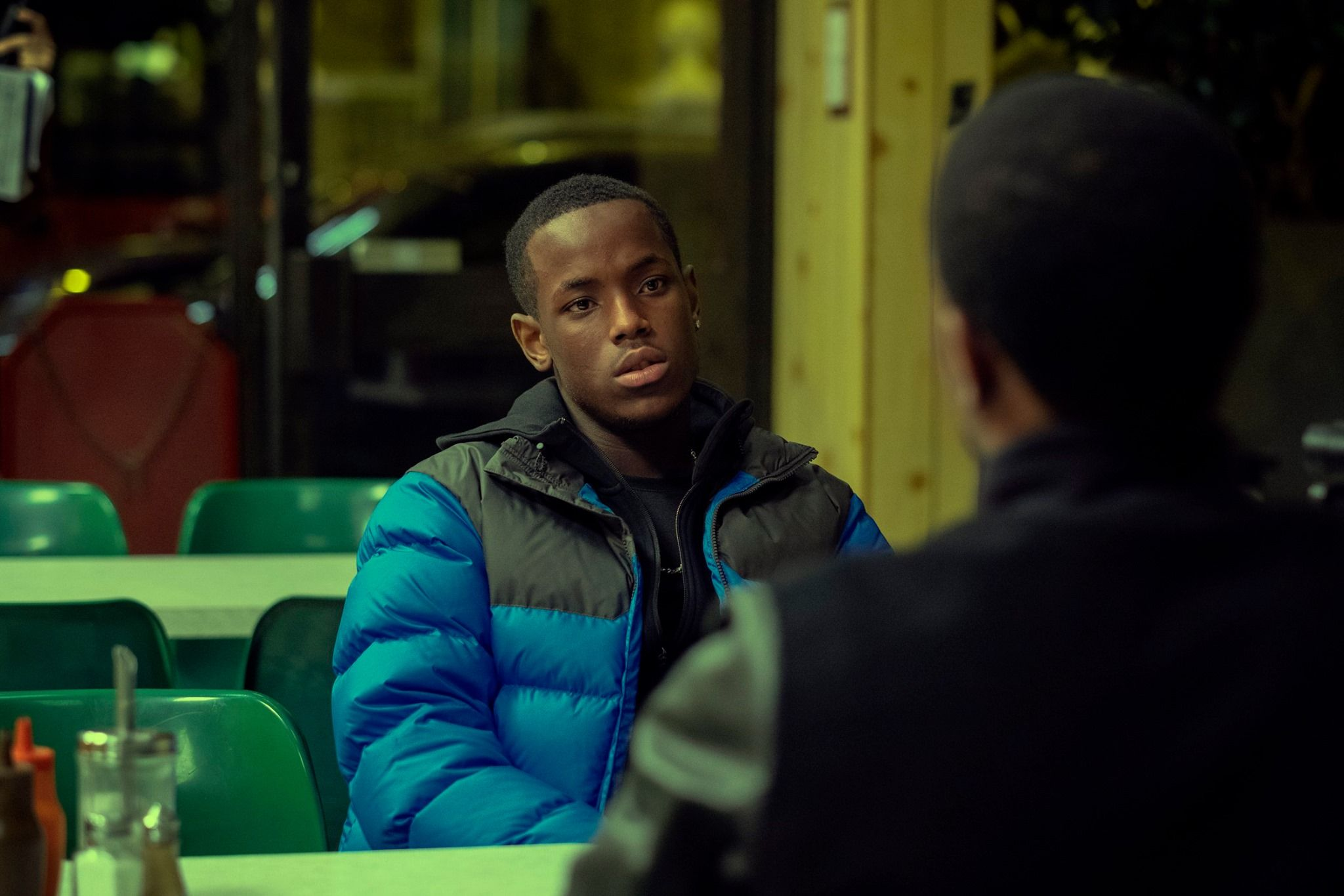 Image may contain: Top Boy, Top Boy season 3, new series, series three, Netflix, Drake, London, new, drama, cast, trailer, release date, Furniture, Chair, Sleeve, Overcoat, Sitting, Coat, Jacket, Apparel, Clothing, Human, Person