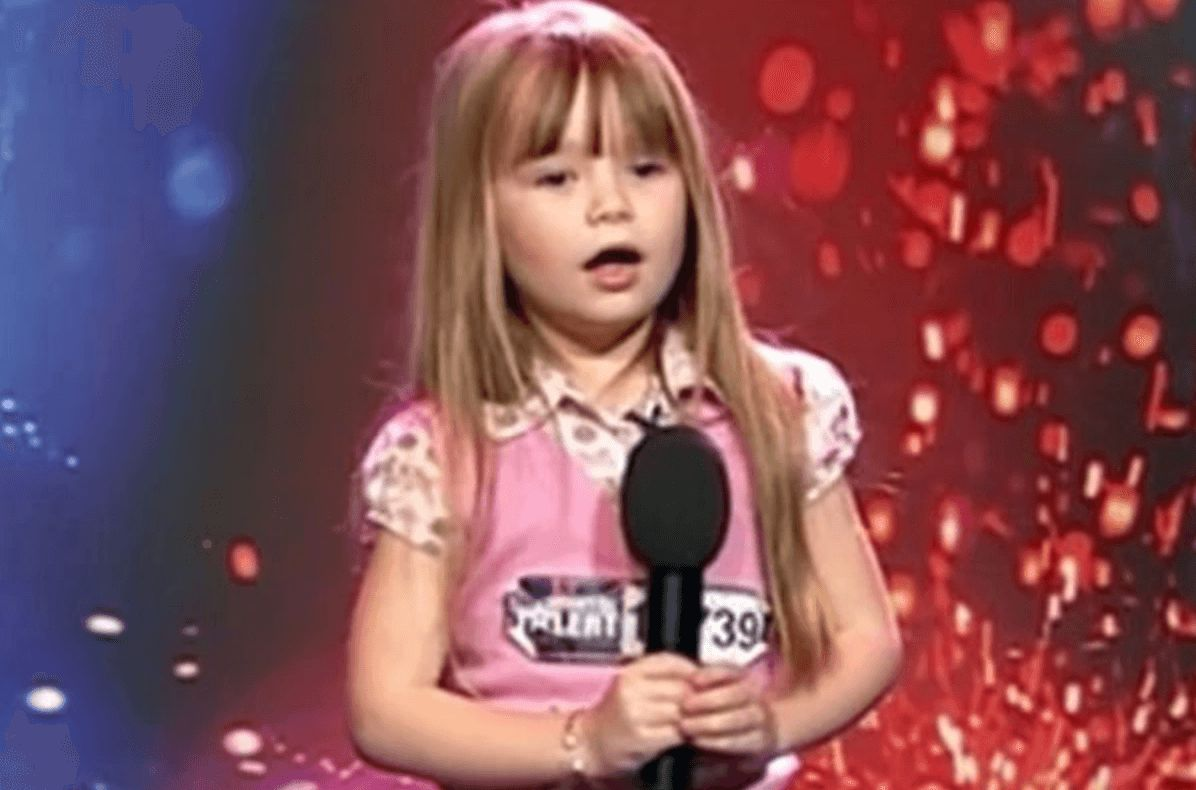 Image may contain: Connie Talbot, Britain's Got Talent, audition, first, performance, 2007, BGT, then, now, before, after, old, young, Over The Rainbow, series one, ITV, Leisure Activities, Karaoke, Duet, Smile, Clothing, Apparel, Face, Woman, Blonde, Child, Teen, Girl, Kid, Female, Lighting, Human, Person