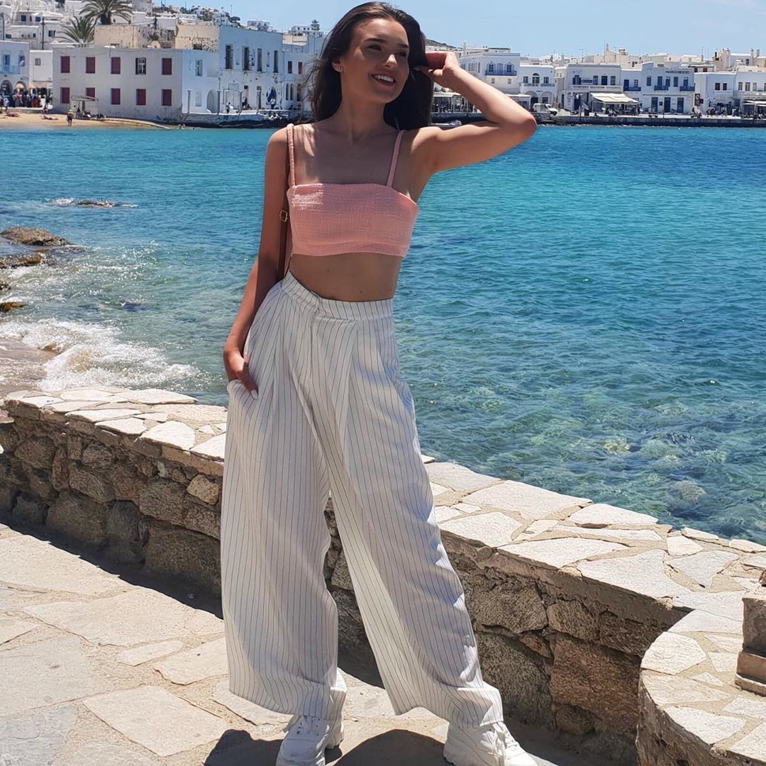 Image may contain: Heartbreak Holiday, BBC, Love Island, Erin White, Erin, cast, contestants, lineup, start date, review, watch, Instagram, age, villa, Pants, Robe, Fashion, Gown, Evening Dress, Female, Sleeve, Flagstone, Person, Human, Clothing, Apparel