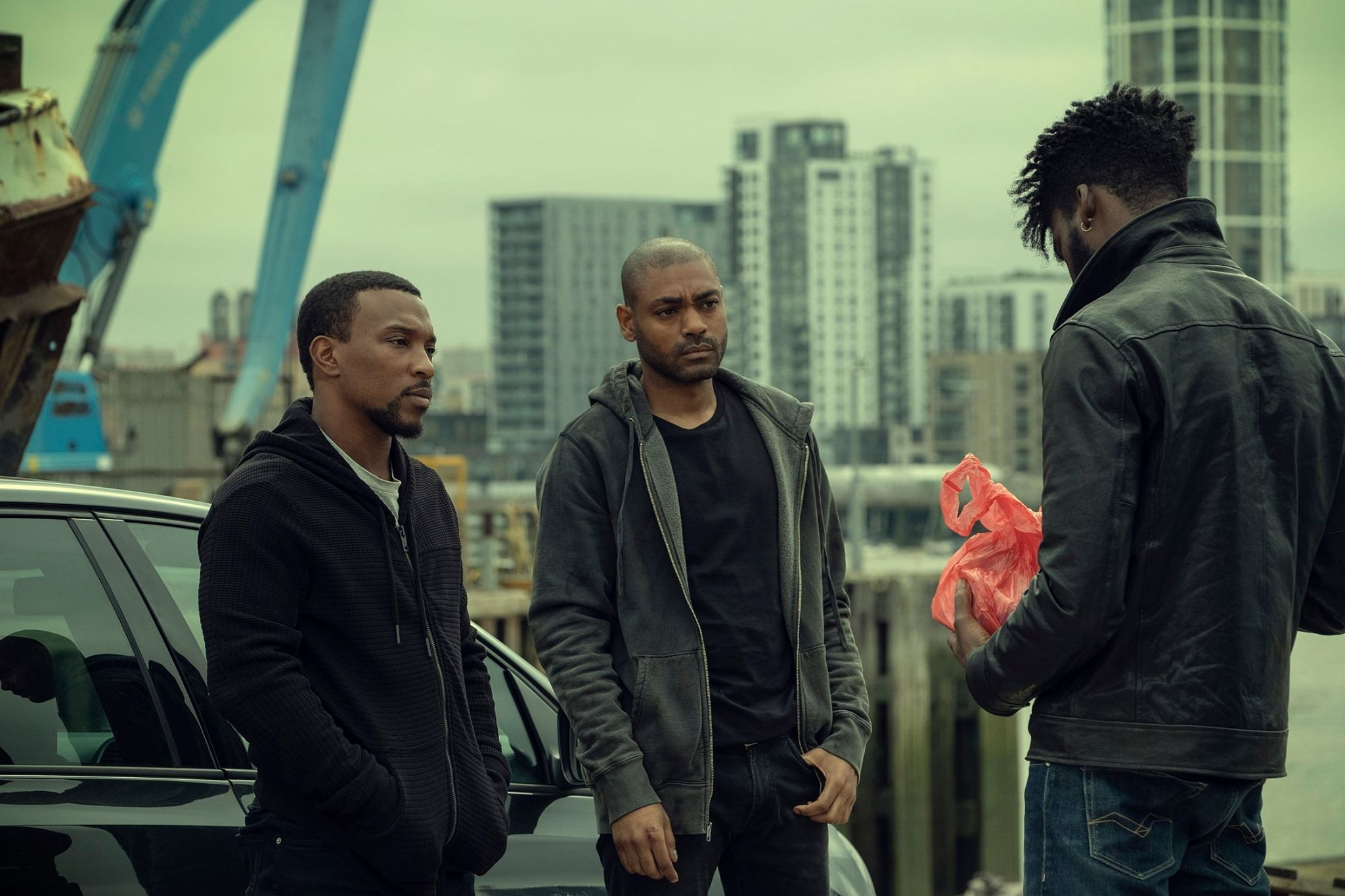 Image may contain: Top Boy, Top Boy season 3, new series, series three, Netflix, Drake, London, new, drama, cast, trailer, release date, Pedestrian, Suit, Man, Hair, Overcoat, Pants, Person, Human, Coat, Jacket, Clothing, Apparel