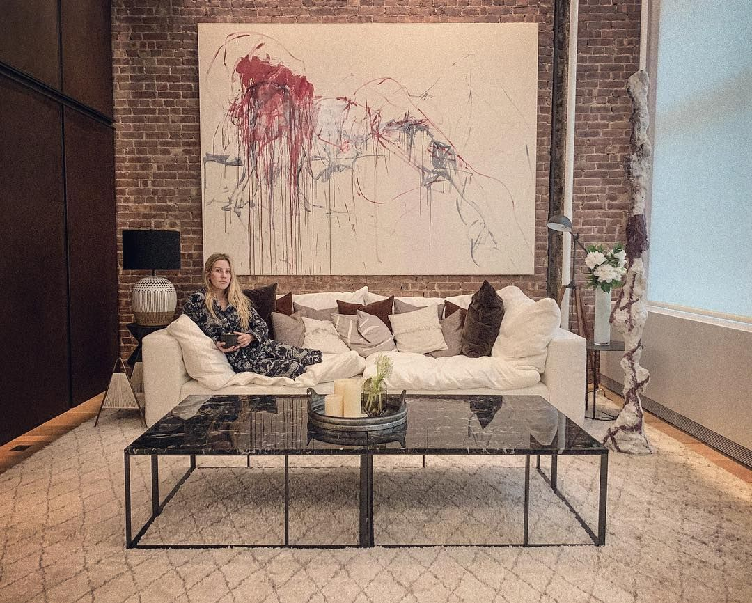 Image may contain: Caspar Jopling, Ellie Goulding, wedding, ceremony, pictures, wife, husband, fiancé, age, Instagram, together, family, job, Soho, New York, apartment, Rug, Coffee Table, Person, Human, Table, Indoors, Living Room, Room, Furniture, Couch