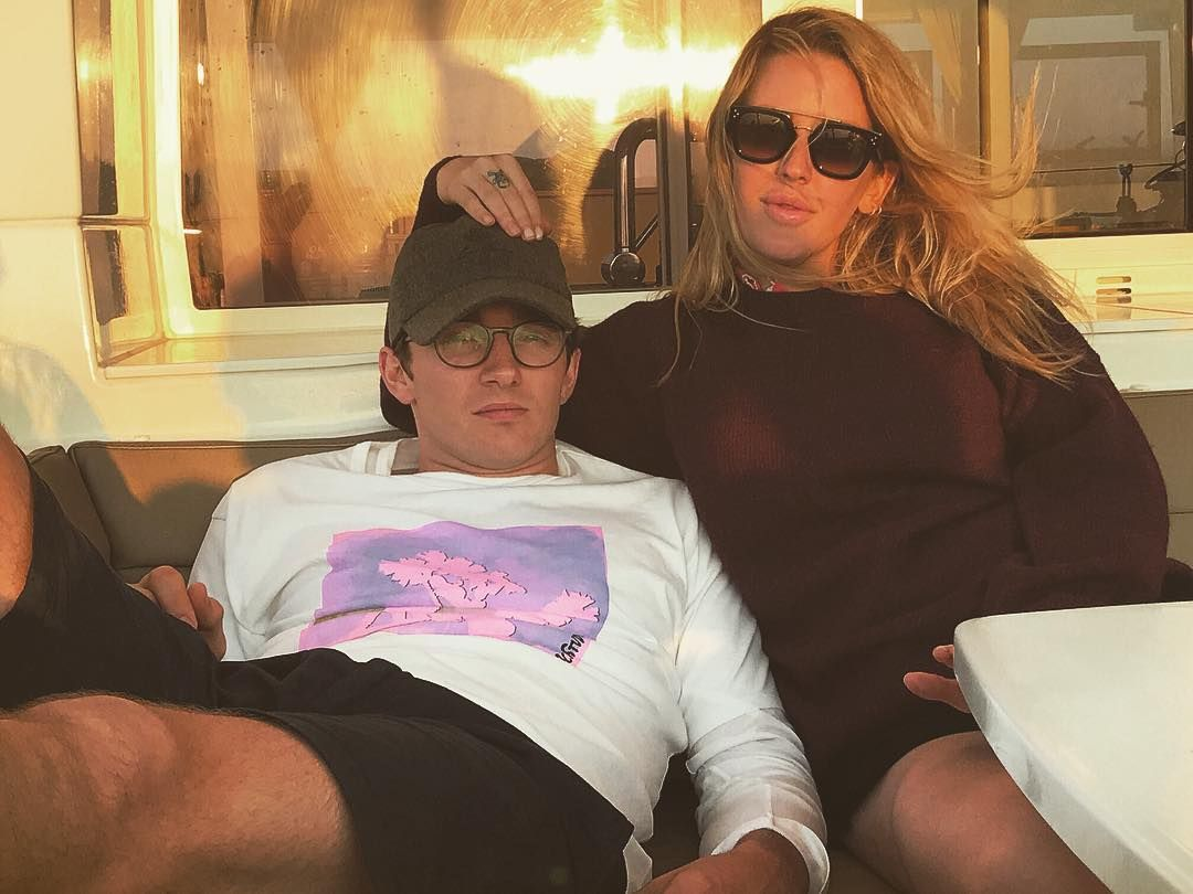 Image may contain: Caspar Jopling, Ellie Goulding, wedding, ceremony, pictures, wife, husband, fiancé, age, Instagram, together, family, job, Sitting, Cushion, Teen, Female, Woman, Child, Kid, Blonde, Girl, Clothing, Apparel, Accessory, Sunglasses, Accessories, Person, Human