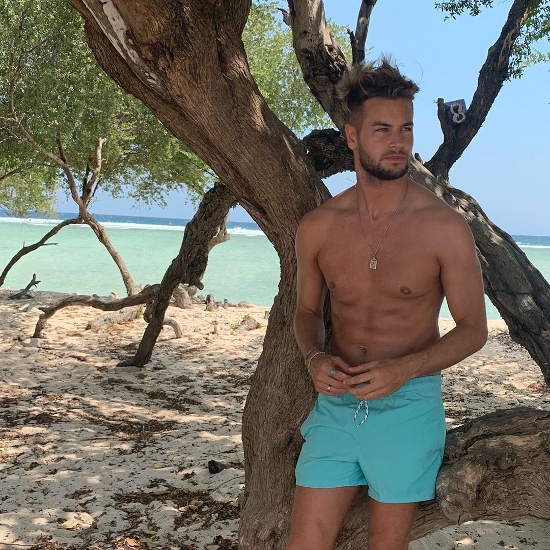 Image may contain: Love Island, gossip, news, latest, rumours, Chris Hughes, Bali, Instagram, Tree, Plant, Skin, Wood, Shorts, Clothing, Apparel, Human, Person