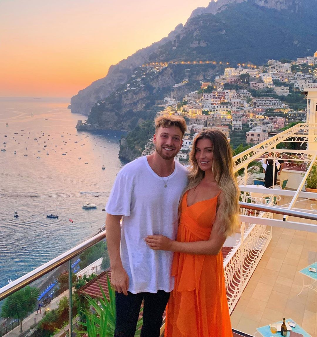 Image may contain: Sam and Zara Made in Chelsea, Sam Thompson, Zara McDermott, Made in Chelsea, new, series, 18, cast, Love Island, relationship, together, Vacation, Evening Dress, Gown, Apparel, Clothing, Fashion, Robe, Railing, Balcony, Person, Human