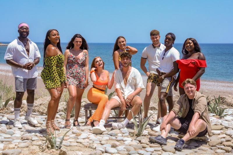 Image may contain: Heartbreak Holiday, BBC, Love Island, cast, Courtney, Sean, Erin, Deano, Jordy, Melissa, Luke, Lauren, Archie, Maxine, contestants, lineup, review, watch, villa, Greece, Mykonos, Vacation, Footwear, Apparel, Shoe, Clothing, Family, People, Person, Human